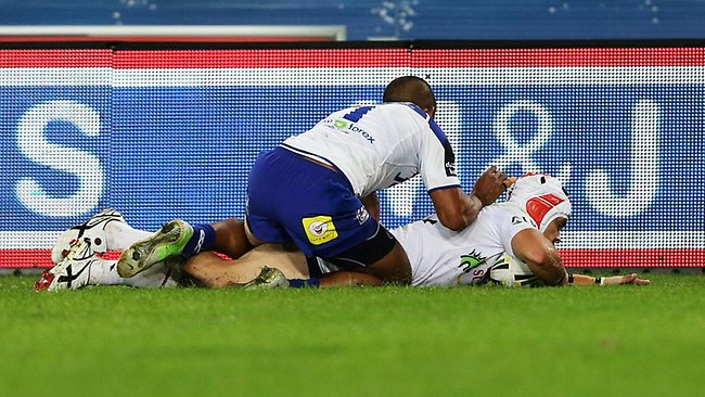 Bulldogs fullback Ben Barba was put on report for this late tackle on Jamie Soward after the Dragons five-eighth had scored a try. Picture: Brett Costello