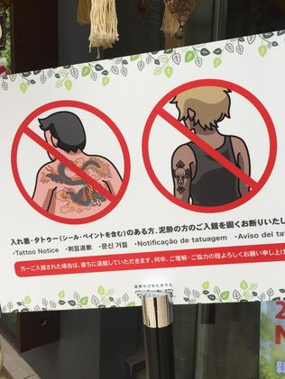 People with tattoos aren't allowed to stay at the capsule hotel.
