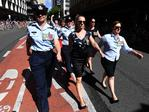Women are seen marching through Brisbane as part of the By the Left group during Anzac Day commemorations in Brisbane. Picture: AAP/Dan Peled