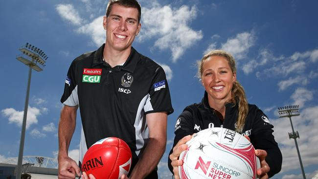 Recently re-signed ruckman/forward Mason Cox and Magpies' Super Netball recruit Erin Bell got back to work on Wednesday. Picture: Getty Images