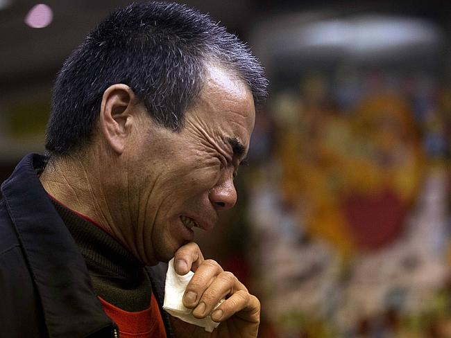Anguish..Feng Zhishang cries as family members mark the birthday of his son Feng Dong, a passenger on board the Malaysia Airlines Flight 370. Picture: AFP