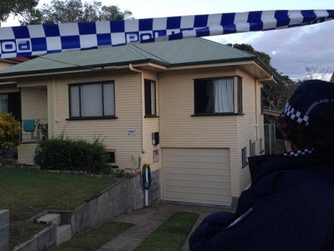 The house in suburban Brisbane where a man's body was found badly burnt in a backyard shed.