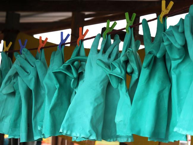 Gloves are disinfected at a volunteer hospital. Pic: AFP.