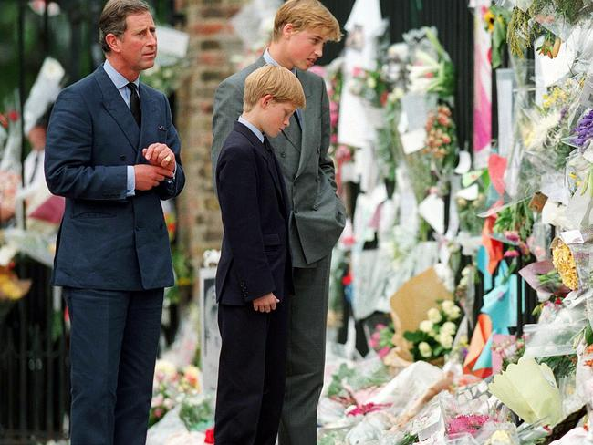 The Prince of Wales, Prince William and Prince Harry look at floral tributes to Diana outside Kensington Palace on September 5, 1997 in London, England. Photo: Anwar Hussein/WireImage