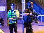 Police and other emergency services are seen near the Manchester Arena after reports of an explosion during an Ariana Grande concert. Picture: Joel Goodman/LNP
