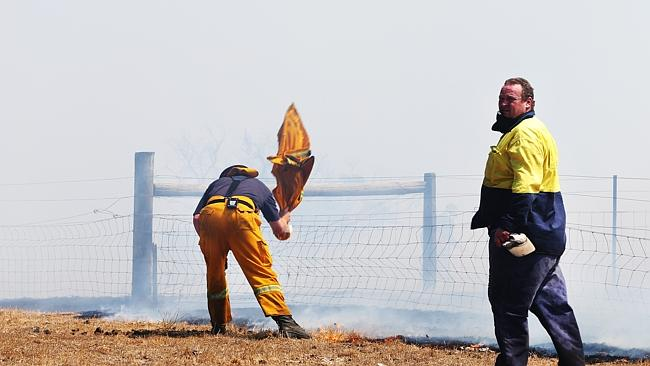 Doing whatever it takes to battle the Wallan and Kilmore fires. Picture: Ian Currie.