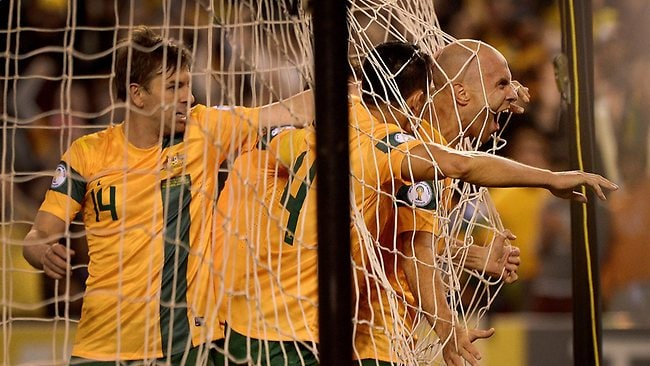 Mark Bresciano celebrates with his Socceroos teammates after scoring the first goal. Picture: Colleen Petch