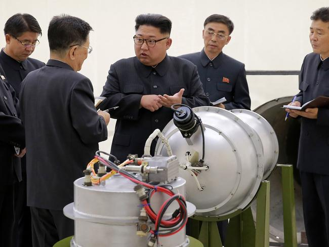 North Korean leader Kim Jong Un with a so called hydrogen bomb ready to be mounted on an ICBM. Picture: AP