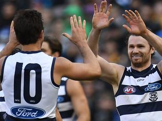 Geelong players Daniel Menzel (left) and Patrick Dangerfield react after Menzel kicked a goal during the Round 17 AFL match between the Geelong Cats and the Hawthorn Hawks at the MCG in Melbourne, Saturday, July 15, 2017. (AAP Image/Julian Smith) NO ARCHIVING, EDITORIAL USE ONLY