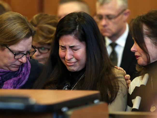 Diane Chism, mother of Philip Chism, sobs while being consoled during her son's sentencing in the murder and rape of Colleen Ritzer. Picture: David Le/The Salem News via AP