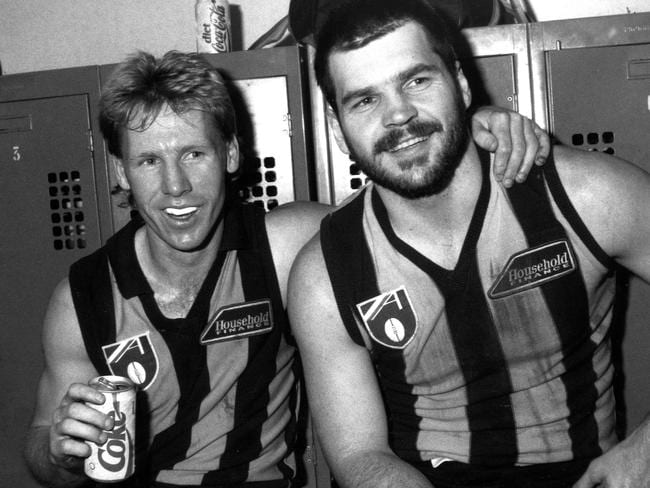 Hawthorn players Andy Collins and Jason Dunstall take in a refreshing, healthy Diet Coke post-match in 1990.