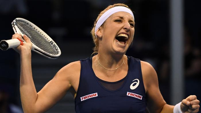 Switzerland's Timea Bacsinszky celebrates her victory against Montenegro's Danka Kovinic during their women's singles second round match on day four of the Australian Open tennis tournament in Melbourne on January 19, 2017. / AFP PHOTO / WILLIAM WEST / IMAGE RESTRICTED TO EDITORIAL USE - STRICTLY NO COMMERCIAL USE