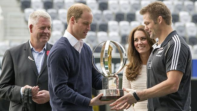 Winner ... Prince William hands over the IRB Junior World Championship Trophy to All Blacks captain Richie McCaw, right, as his wife Kate, the Duchess of Cambridge watches. pIC: SNPA, David Rowland