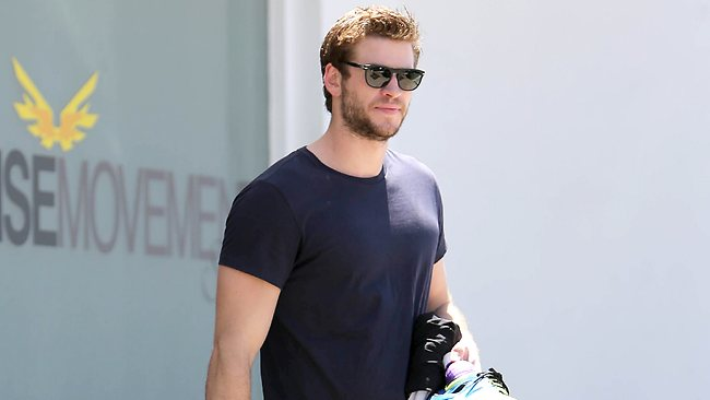 Liam Hemsworth leaves the gym after a workout amid reports that he and fiance Miley Cyrus broke up. Picture: Splash