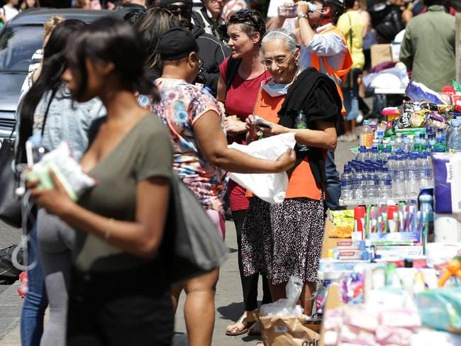 People drop off donations of food and drink at makeshift centres where many are looking for news of loved ones. Picture: AFP/ DANIEL LEAL-OLIVAS