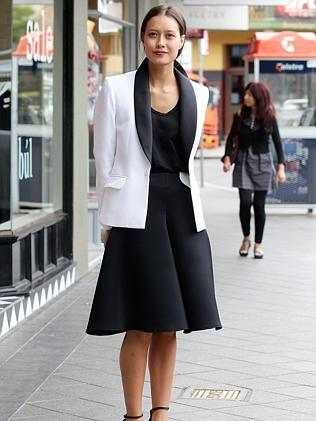 "Kim Dendle , 21, Mona vale. "" I think the people are more advernturous with their fashion in Melbourne. In Sydney, its more high fashion and sophisticated.""/ Wearing - All josh goot worth - $3000."