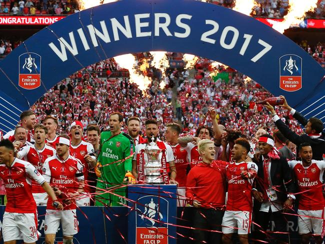 Arsenal's players celebrate after their win over Chelsea on the pitch after the English FA Cup final football match between Arsenal and Chelsea. Picture: AFP
