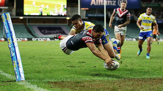Roger Tuivasa-Sheck scores one of his three tries in the Roosters' 50-0 rout of the Eels.