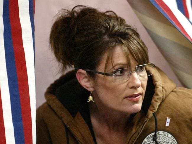 Just one vote ... then Republican vice-presidential nominee Sarah Palin emerges from a voting booth after casting her vote during the 2008 US presidential elections.