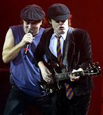 "<p>Angus Young (R), lead guitarist with Australian rock band AC/DC and lead singer Brian Johnson (L) play during the band's concert at the Hammersmith Apollo, London, in this October 21, 2003 file photo. The band has topped pop charts around the world with their first album in eight years entitled""Black Ice"", proving that fans never tire of a middle-aged guitarist who dresses like a schoolboy and a singer whose voice sounds painfully raspy. REUTERS/Toby Melville/Files (BRITAIN)</p>"