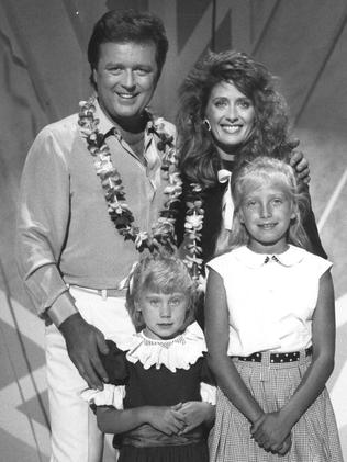 1988. TV host Johnny Young with singer Debra Byrne and her children Lauren and Arja.