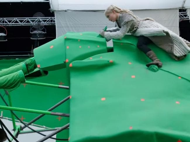 Clarke struggles to stay in character on this giant green thing.