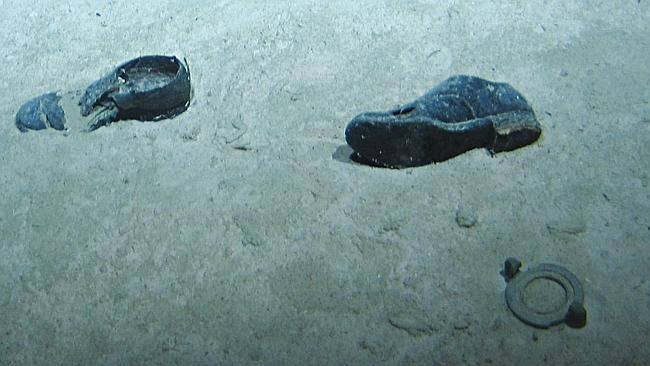 Poignant presence ... a pair of boots sitting in the mud alongside the wreck of HMAS Sydney is a stark reminder of the fate of her 650 crew.