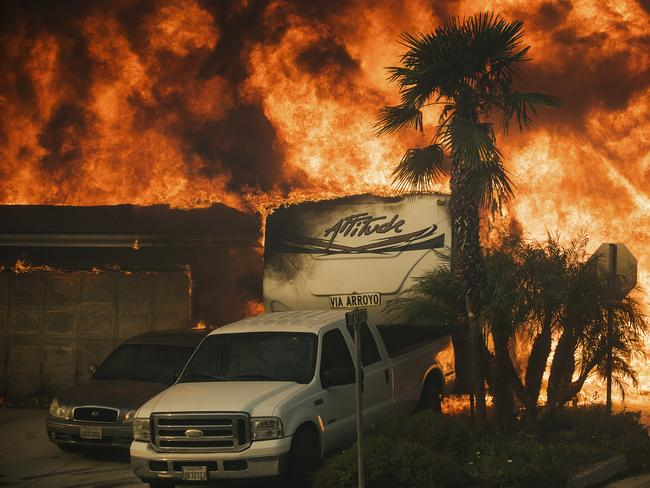 Flames consume a home on Via Arroyo in Ventura. Picture: AP Photo/Noah Berger