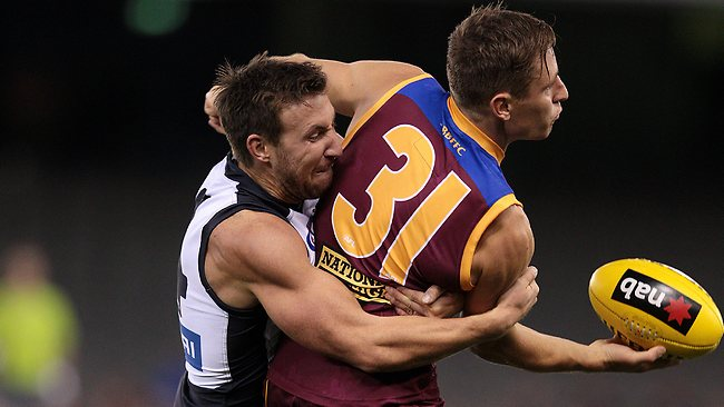 Brocl McLean tackles James Polkinghorne Picture: Andrew Tauber