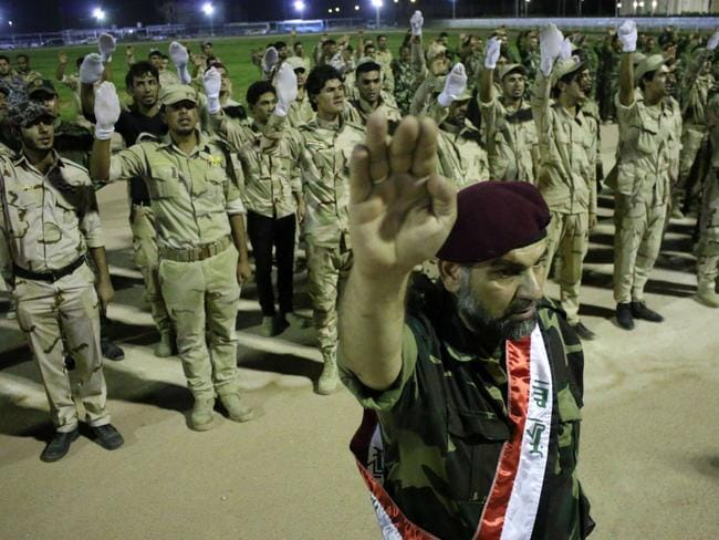 Fighting back ... Iraqi Shiite volunteers from the University of Basra that have joined government forces to fight Sunni jihadists from the Islamic State (IS) take part in a graduation ceremony. Picture: AFP