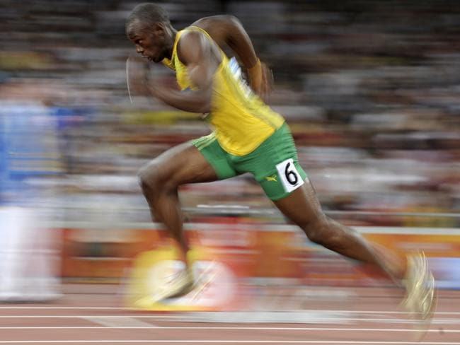 Usain Bolt explodes out of the blocks.