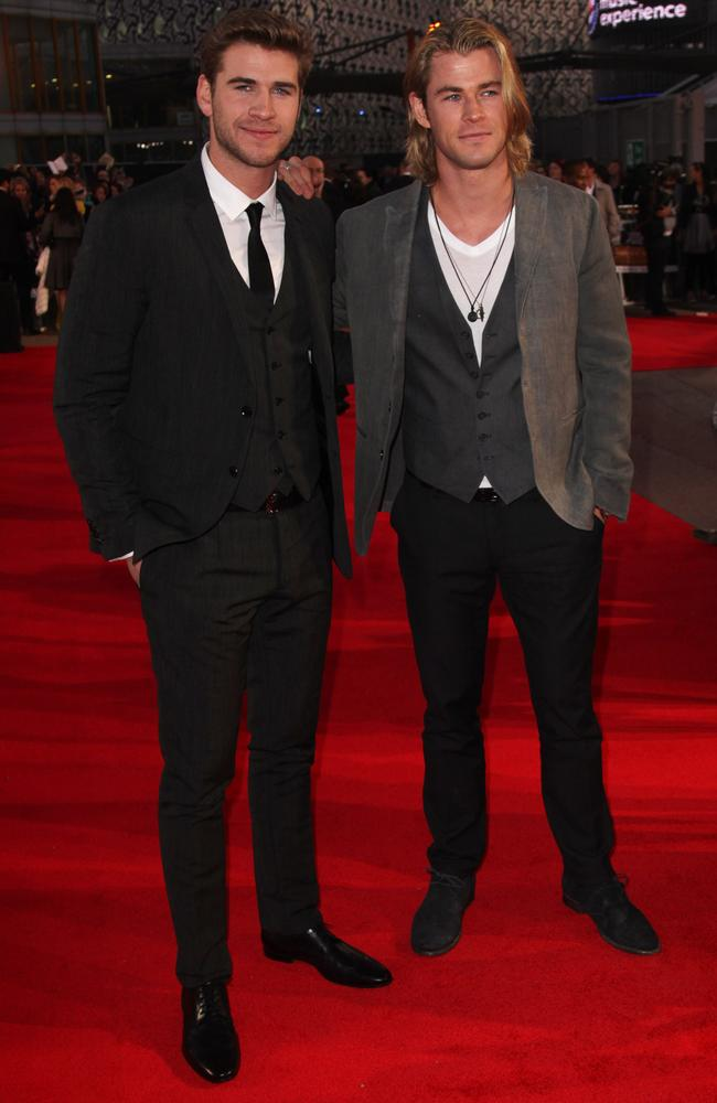Aussie exports...Liam and Chris Hemsworth attend the European premiere of The Hunger Games. Picture: Getty