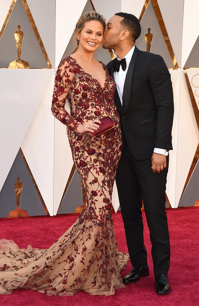 Pregnant Chrissy Teigen and John Legend attend the 88th Annual Academy Awards on February 28, 2016 in Hollywood, California. Picture: AP