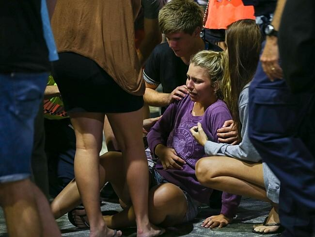 A girl is comforted by friends after falling to the ground. Pic: Lindsay Moller