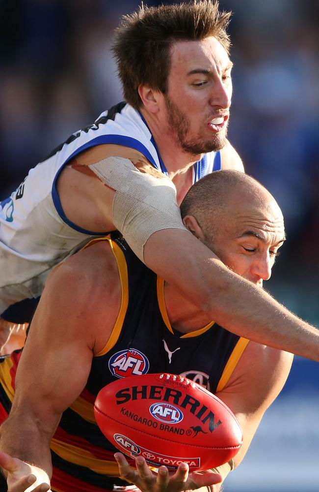 Crow James Podsiadly is taken high by Kangaroo Sam Wright late in the game. Picture: Getty
