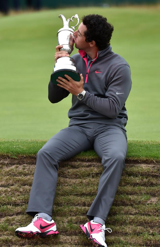 Rory McIlroy kisses the Claret Jug as his poses for a photograph after winning the 2014 British Open.