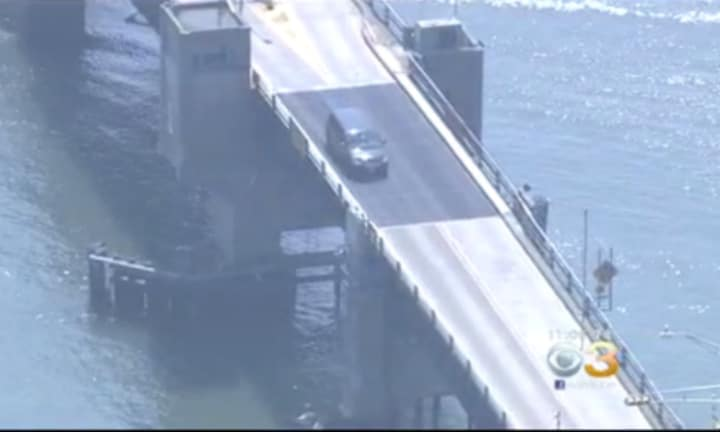 Dad launches car with family inside over opening drawbridge