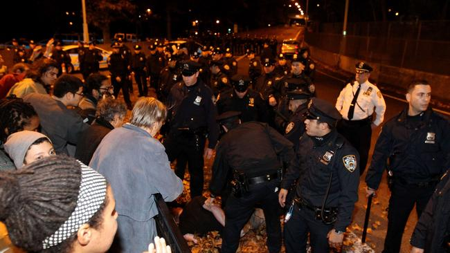 a man protesting the Ferguson ruling gets detained by New York police officers. Picture: Justin Heiman/Getty Images/AFP