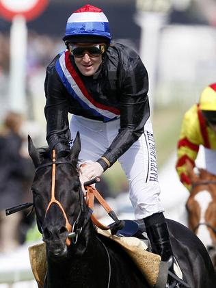 Jockey Pat Cosgrave after winning the 2011 Golden Jubilee Stakes on Society Rock.