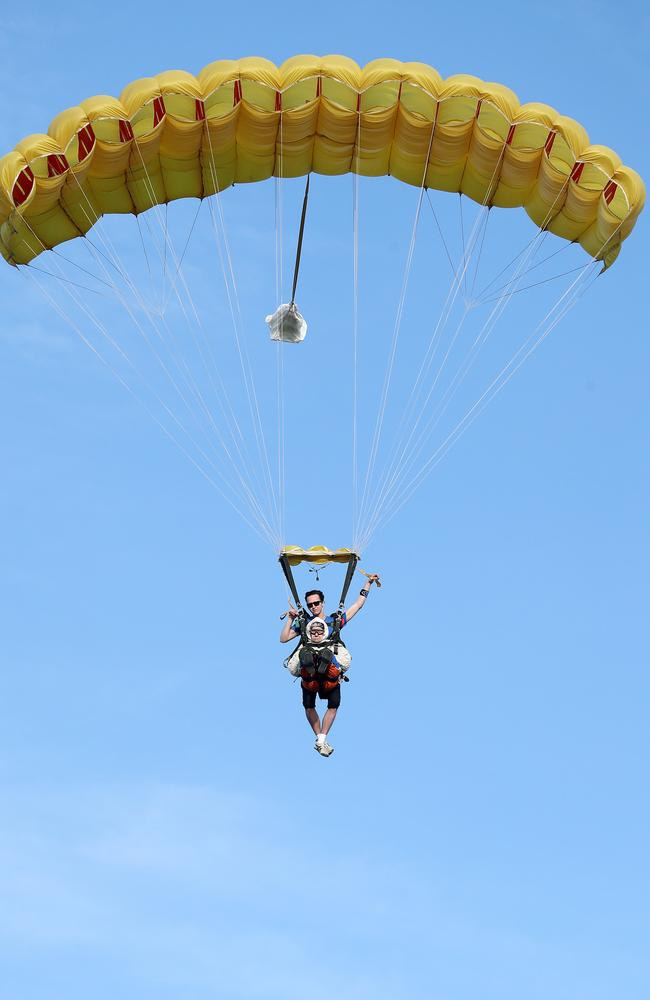Aloft ... Irene O'Shea comes in to land with tandem partner SA Skydiving's Jed Smith. Picture: Calum Robertson