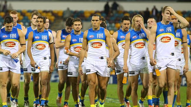 A shattered Suns line-up leaves the field after being belted by Brisbane on Saturday night. Picture: Getty Images
