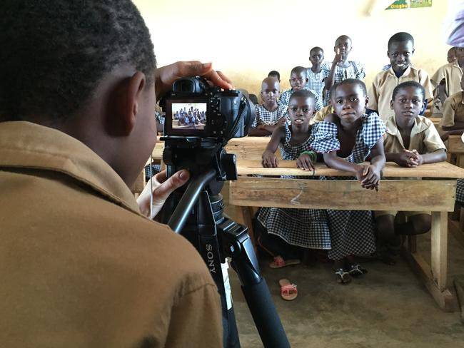 At the Goboue school, built by Nestle, students like aspiring filmmaker Marcel (behind the camera) can gain an education. Most of the students had either not gone to school or had to walk up to 15km in unsafe and unclean conditions to reach their nearest school.