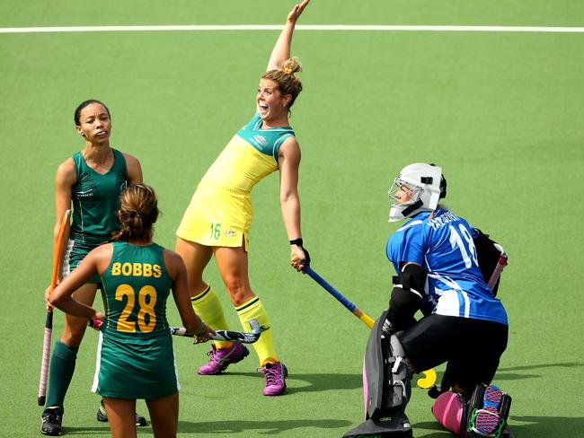 Kellie White of Australia celebrates scoring the second goal in the Women's Hockey Semi Final between South Africa and Australia.