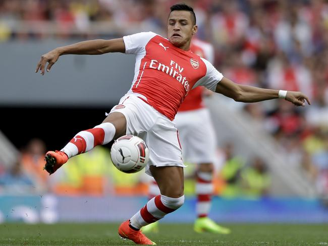 Making his debut, Arsenal's Alexis Sanchez shows his technique against Benfica at the Emirates.