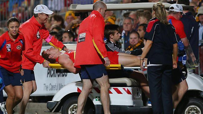 Gold Coast defender Rory Thompson stretchered off the ground after a heavy knock. Picture: Getty