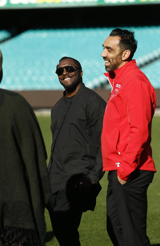 Awesome ... Swans star Adam Goodes gives Team Will a pep talk, with coach will.i.am. Picture: Tim Hunter