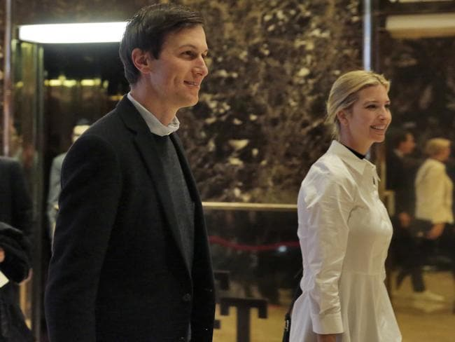 Jared Kushner and his wife Ivanka Trump walk through the lobby of Trump Tower in New York. Picture: AP Photo/Richard Drew