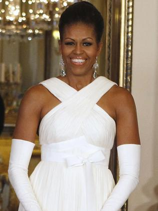 First lady Michelle Obama in her Tom Ford creation. Picture: AP