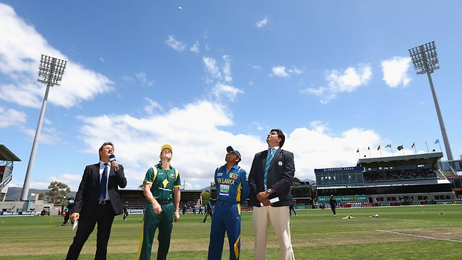 Australian captain George Bailey tosses the coin prior to game five of the one-day series against Sri Lanka in Hobart. Picture: Robert Cianflone