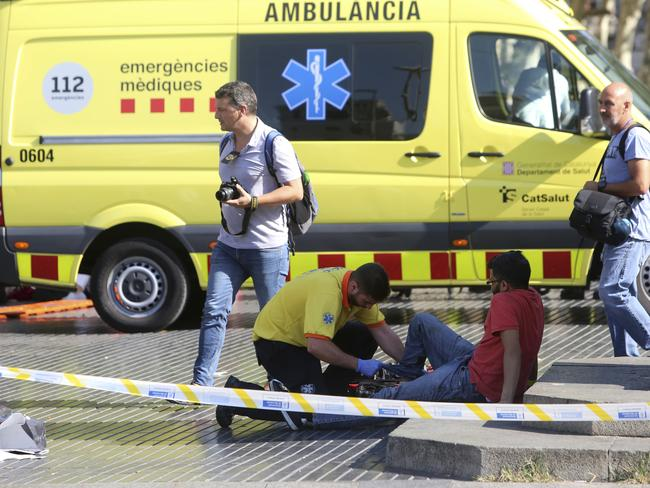 An injured person is treated in Barcelona, Spain. Picture: AP